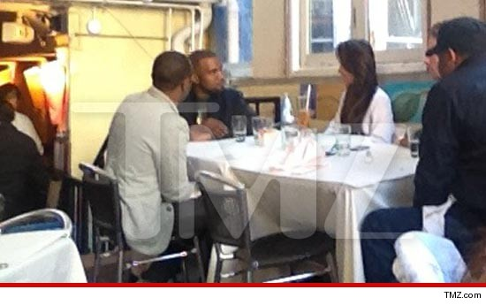 Kanye West and Kim Kardashian eat lunch.
