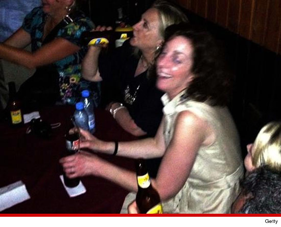 Hillary Clinton drinking beer in Colombia