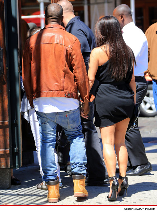 Kanye West and Kim Kardashian holding hands in NYC