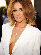 Miley Cyrus Reveals Cleavage at Billboard Music Awards in Daring Dress