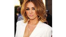 Miley Cyrus Reveals Cleavage at Billboard Music Awards in Daring Dress