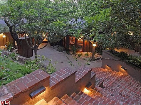 "The 1,861 sq. ft. pad -- locally dubbed the ""treehouse"" because of its surrounding dense foliage -- has had many celebrity owners ... including Ellen DeGeneres, who sold the place to Heath Ledger and his then-girlfriend Michelle Williams."