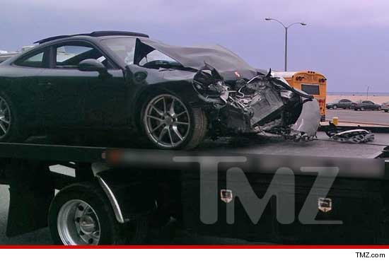 Lindsay Lohans wrecked porsche in tow