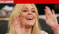 Lohan Settles Up with 2007 Car Chase Victim