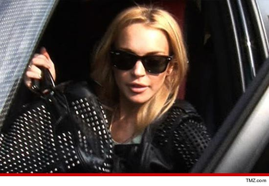 0609_lindsay_lohan_tmz_car
