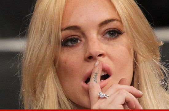 0611_llindsay_lohan_lying_article_2
