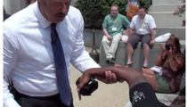 Dr. Phil to the Rescue -- After Photog Takes a SPILL