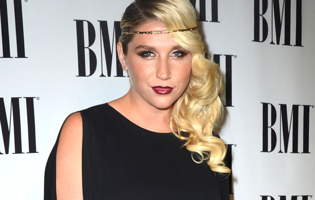 "Ke$ha Shows Off New ""Suck It"" Lip Tattoo"