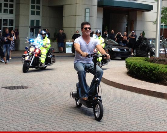 Just Simon Cowell on a scooter.