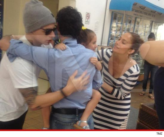 Casper Smart in a great, big bro hug with Marc Anthony.