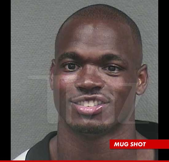 Adrian Peterson and the smiley mug shot