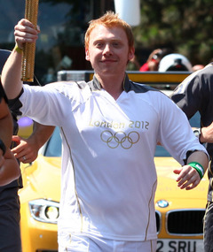 """Harry Potter"" Star Rupert Grint Carries the Olympic Torch!"