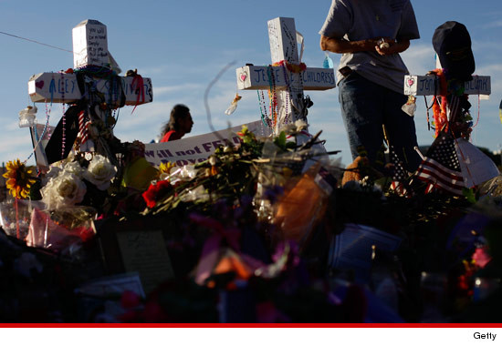 0727_aurora_colorado_shootings_funeral_paid_article_2
