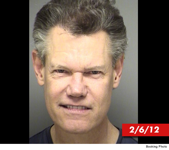 0808_randy_travis_february_mugshot_v2