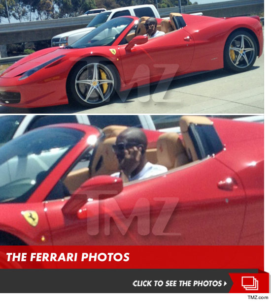 0822_kobe_bryant_ferrari_cell_phone_launch