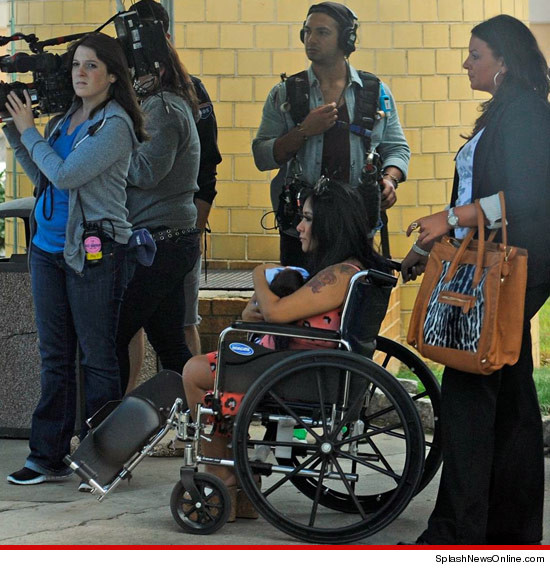 Snooki leaves the hospital with baby Lorenzo LaValle.