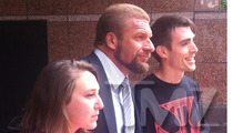 Triple H -- WWE Superstar ... SHAVES HIS HEAD!!!