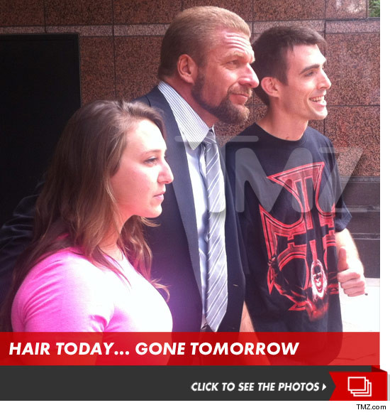 WWE's Triple H gets a haircut, donates grease to KFC