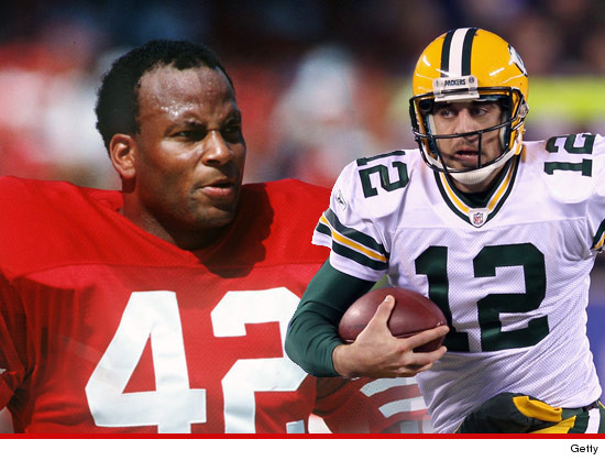 0914-ronnie-lott-aaron-rodgers-getty