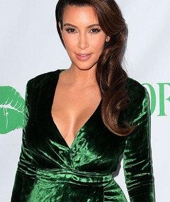Kim Kardashian Shows Some Skin In Velvet Green Dress