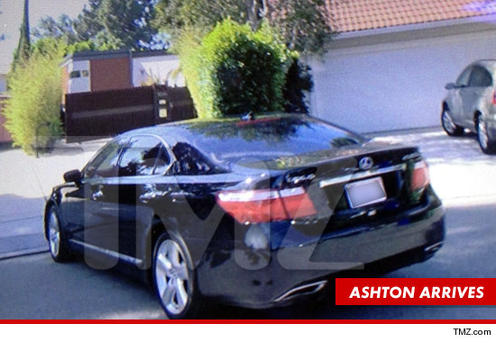1003_ashton_kutcher_Arriving_home_swatting_tmz