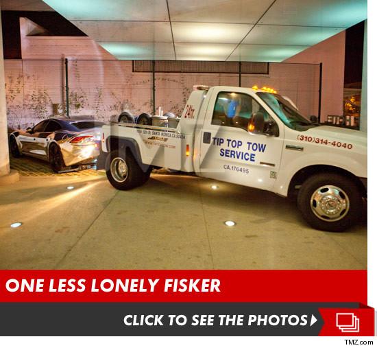 1003_justin_bieber_car_towed_fisker_karma_launch_v2