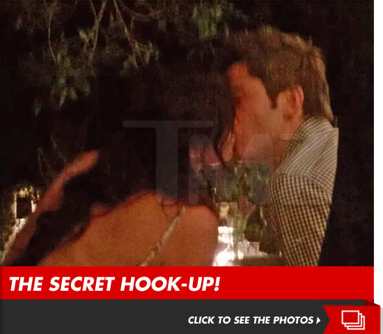 Courtney Robertson kissing Arie Luyendyk