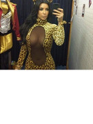 Kim Kardashian Tries On Very Revealing Halloween Costume!