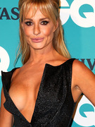 Taylor Armstrong Turns Heads Down Under in Daring Dress!