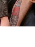&quot;Twilight&quot; Star Shows Off His Ketchup Bottle Tattoo