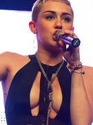 Miley Cyrus Sports Revealing Top And Shorter Hair!