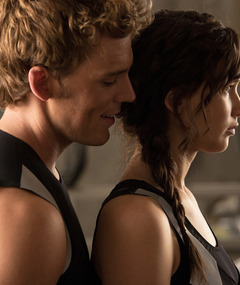 "See Katniss, Finnick & Peeta In New ""Catching Fire"" Pics"