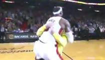 LeBron James -- Bear Hugs Fan After Halfcourt Shot