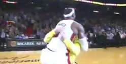 LeBron James -- Bear Hugs Fan After Halfcourt Shot