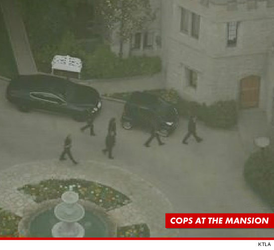 0221-playboy-mansion-cops