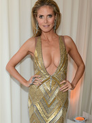 Heidi Klum Flaunts Major Cleavage at Oscar Party