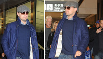 Leonardo DiCaprio -- Heads Up at the Airport