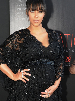 Kim Kardashian Hits Red Carpet with Baby Bump