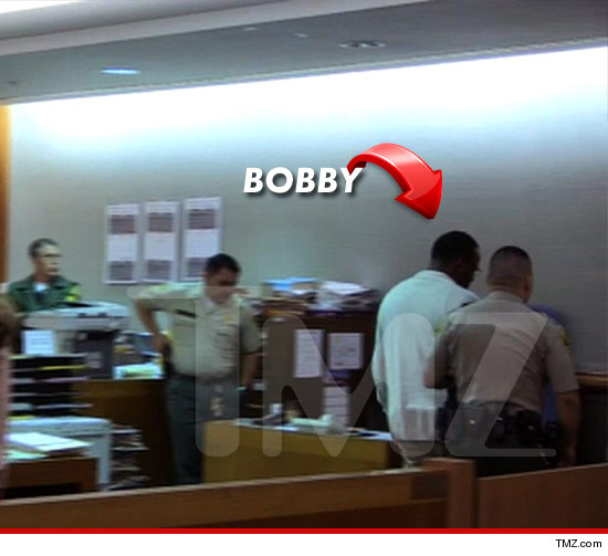 0320-bobby-brown-cuffed-tmz