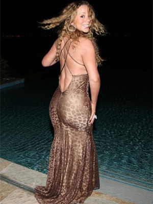 To Celebrate Her Wedding Anniversary, Mariah Carey Trashed a Designer Dress and Pretended to Be a Mermaid