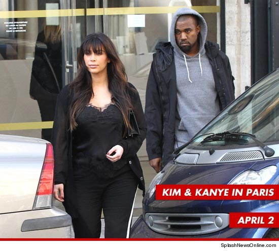 kim_k_pregnant_kanye_west_paris_splash