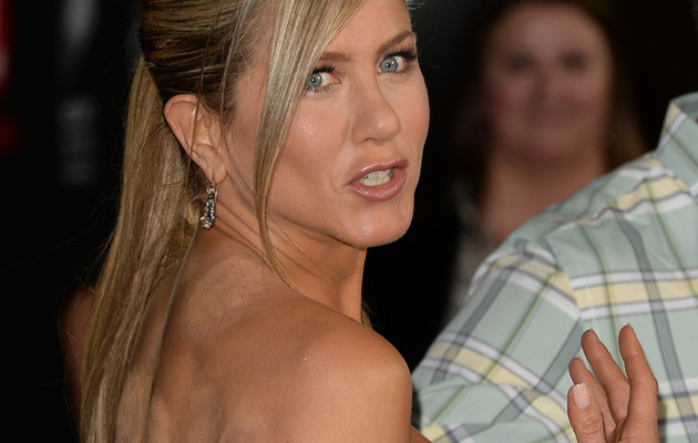 Jennifer Aniston Tries to Cover Up Weird Cupping Marks, Fails