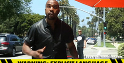 Kanye West -- FLIPS OUT on Photog After Slamming Head on Sign