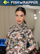 Kim Kardashian Really Wants Us to Believe That Her Lips Are Pregnant, Too