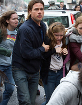 "Brad Pitt Faces Zombie Threat In New ""World War Z"" Clips"