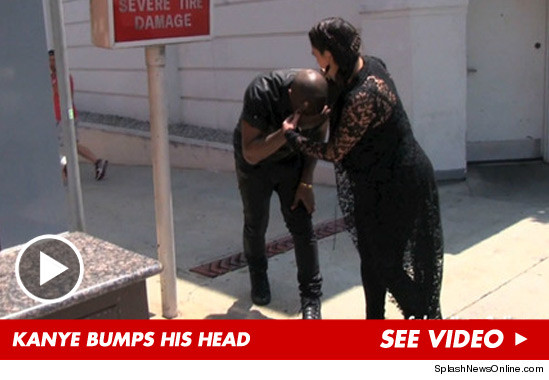 0611_kanye_bumps_head_article