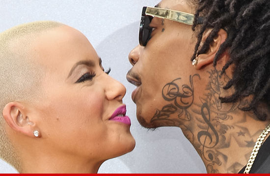 0702_amber_rose_wiz_khalifa_article_getty