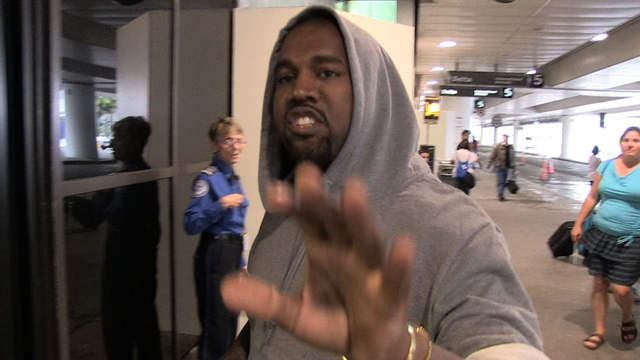 071213_kanye_pap_attack_primary