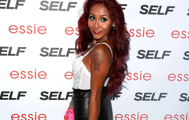 Snooki Flaunts Weight Loss In Tight Leather Skirt!