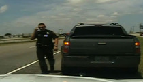 George Zimmerman Traffic Stop -- Cop Under Investigation for Sneaky iPhone Pic